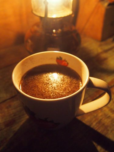A mug of hot chocolate prepared Belizean style with black pepper.