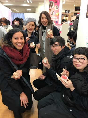 Kaija eating ice cream with friends in Japan